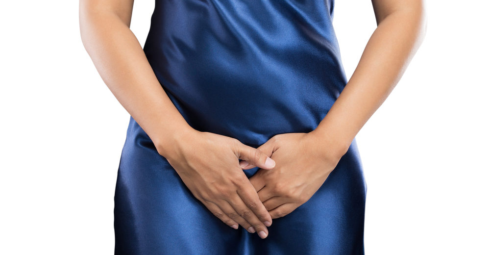 woman in blue with chronic cystitis symptoms